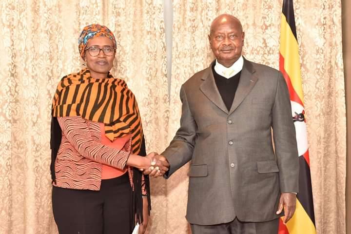Winnie Byanyima shakes Museveni