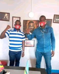 Innocent Tegusuulwa and People Power's spokesperson Joel Ssenyonyi (left).
